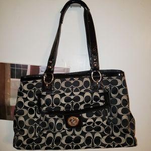 Black and grey Coach purse